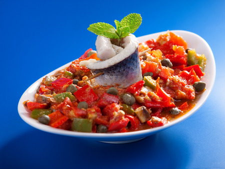 red peppers: Tunisian salad with red peppers, marinated fish and capers. Full length.