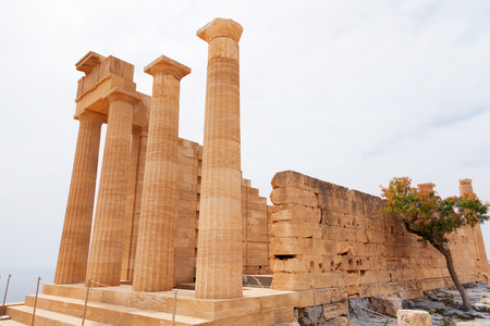 rhodes: Ancient columns on Lindos, Rhodes island, Greece. Vertical shot Stock Photo
