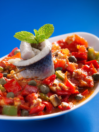 red peppers: Tunisian salad with red peppers, marinated fish and capers. Vertical shot Stock Photo
