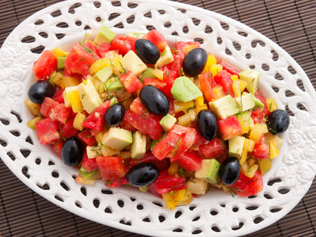 Healthy salad with avocado, tomatoes, olives and green peppers Stock Photo