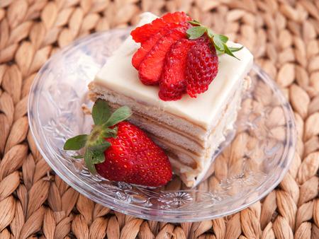 vanilla cake: Vanilla cake with strawberry over wooden background. Horizontal shot