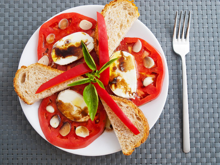 balsamic: Caprese salad with toasts and balsamic vinegar. Shot from above Stock Photo