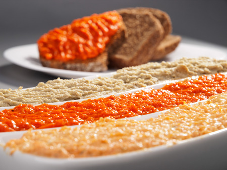 brea: Three types of dips - mayonnaise, tomato dip and eggplant dip. Close up, bread slices on background Stock Photo