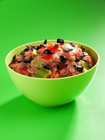 Tunisian salad with tomatos tuna fish and olives. Vertical shot Stock Photo