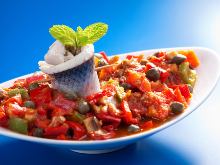 red peppers: Tunisian salad with red peppers, marinated fish and capers. Horizontal shot Stock Photo