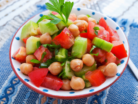 garbanzos: Salad with tomatoes, cucumbers and chickpeas. Horizontal shot