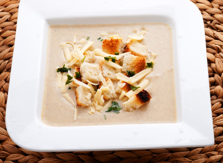 croutons: Mushroom creamy soup with cheese and croutons