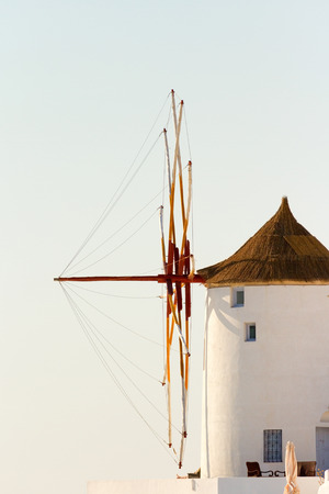 oia: Famous windmill in Oia, Santorini at daylight