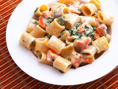 sour cream: Italian rigatoni pasta with salmon and sour cream. Horizontal shot