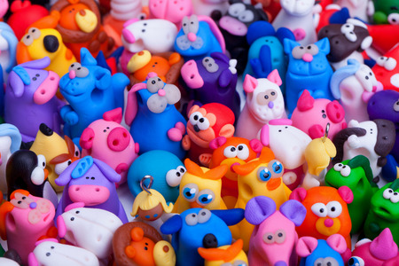 Large group of clay toys. Horizontal shot, high angle view