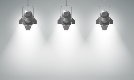limelight: Realistic hanging spotlights composition with three bright beams in empty space on grey background vector illustration