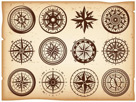 Vintage nautical compasse icônes configurées sous différentes formes sur papier parchemin fond isolé illustration vectorielle