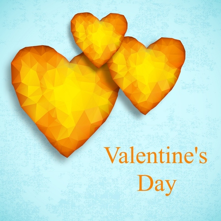 Yellow valentines day design composition with three amber hearts on light blue
