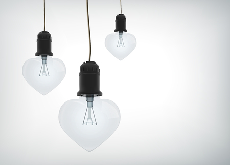 Light amorous design concept with realistic electric bulbs in heart shape hanging on wires isolated vector illustration