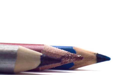 Cosmetic pencils isolated on white closeup photo