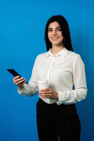 businesswoman with smartphone, look at camera, smile.  medium shot