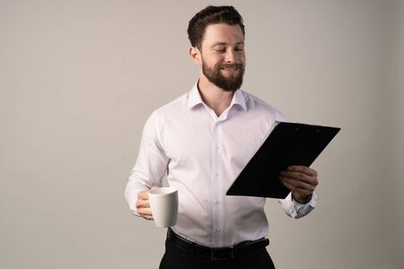 Young White Businessman Glad to recieve a Good News or High Profits from Computer Laptop, Own Business Achieves Goals.Celebrating Success