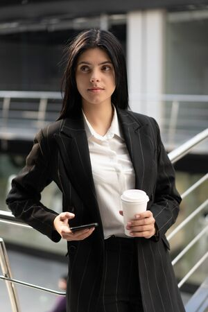 young success woman, looking on the side, resting from the work, thinking of something. Young girl from startup company