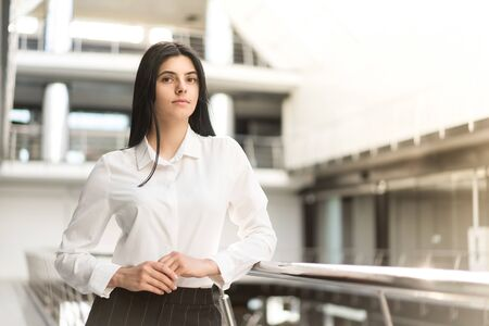 Young girl in a business suit posing on a white background, business style, business woman.