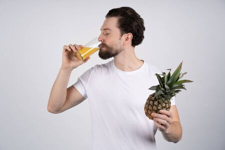 Man with long beard eat lemon. Fruit and healthy organic food. Dieting and fitness. Vitamin citrus at hipster on yellow background. Vegetarian, health and wellbeing, copy space Stock fotó