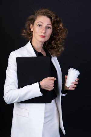 Beautiful business woman with coffee and documents ready to start your working day, it is strict and sure always planning their business Stock fotó
