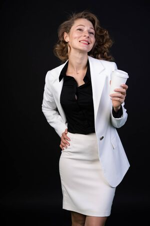 Happy girl in a business suit, she is cheerful and active, open and communicative