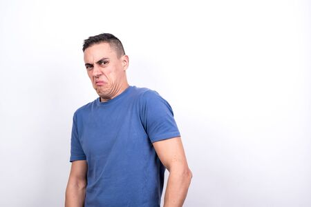 Disgusted man retreating, on white background. Middle plane Stock fotó