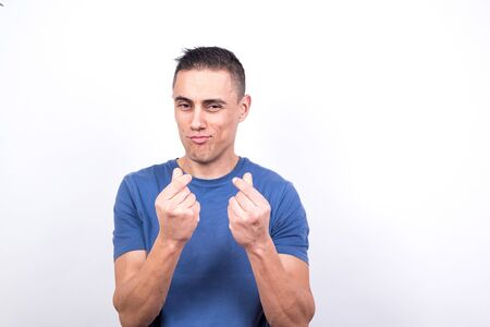 Man referring to money making a hand gesture. White background, medium shot