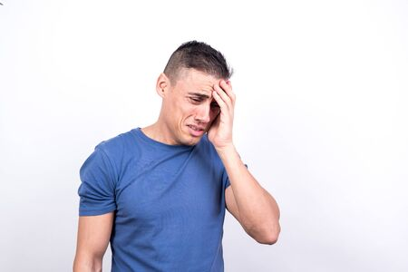 Crying man. white background, medium shot