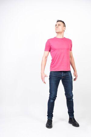 Self-confident man. White background, full body Reklamní fotografie