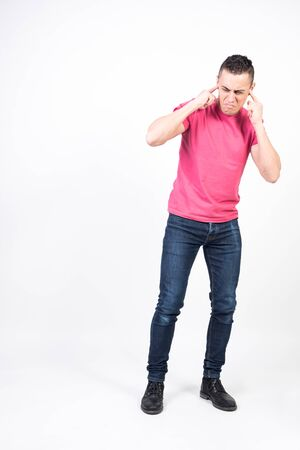 Man disgusted by noise. White background, full body