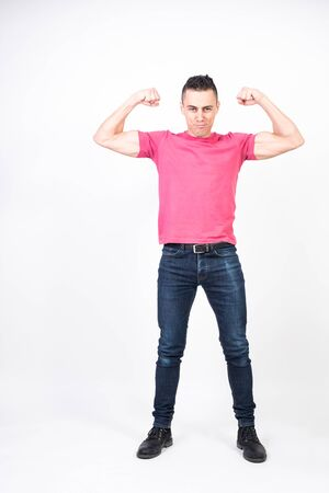 Man pulling out biceps. white background, full body