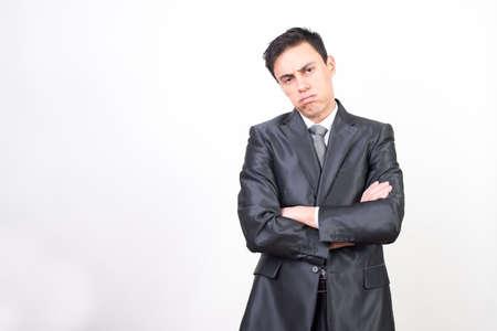 Bored man in suit, on white background, medium shot