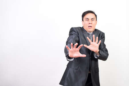 Scared man in suit on white background, medium shot