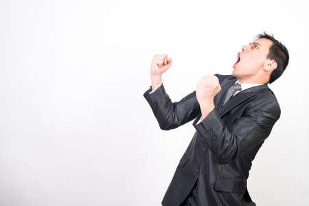 Euphoric man in suit celebrating something. White background. Middle plane