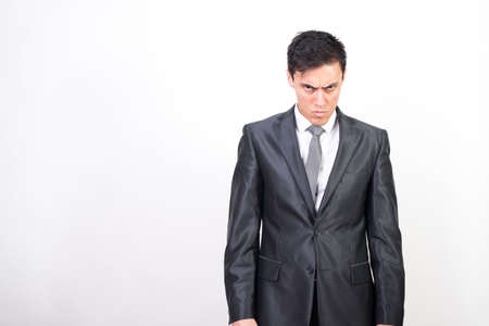 Angry man in suit. white background, medium shot Stockfoto