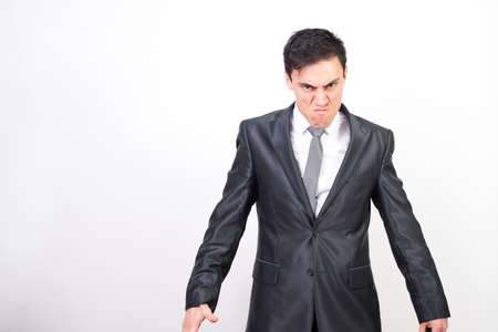 Angry man in suit. white background, medium shot