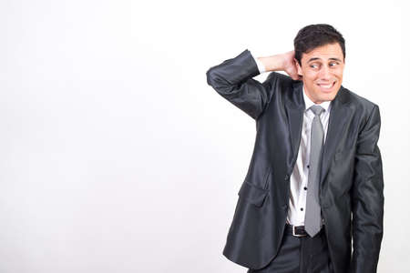 Shy man in suit. White background, Medium shot Archivio Fotografico