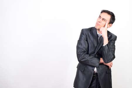 Dreamy man in suit. White background, Medium shot Stock Photo