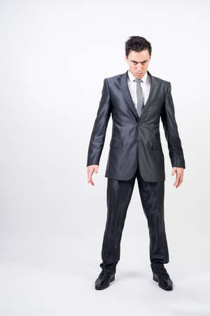 Challenging man in suit. White background. Full body Stock Photo