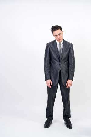 Bored man in suit on white background, full body