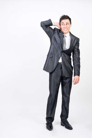 Shy man in suit. White background, full body