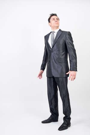 Arrogant man in suit. White background, full body
