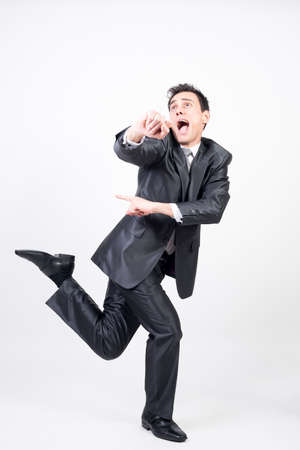 Silly man in suit. White background, full body
