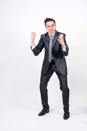 Angry man in suit. white background, full body