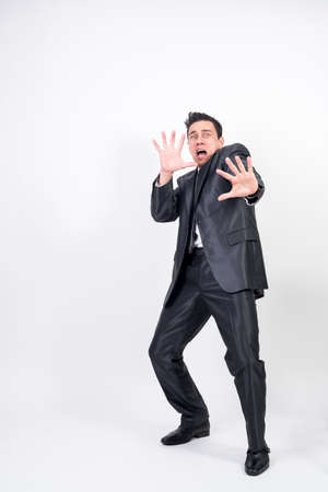 Scared man in suit on white background, full body