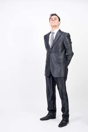 Vigilant man in suit. White background, full body