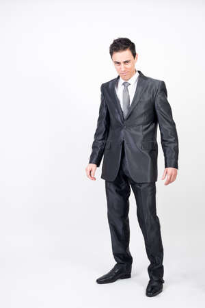 Seductive man in suit. White background, full body