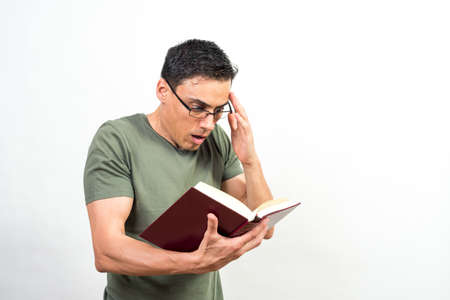 Man reading something that is surprising him a lot in a book. Mid shot. White background.
