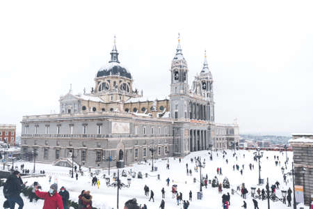 Almudena Cathedral in Madrid on a winter day after a heavy snowfall.